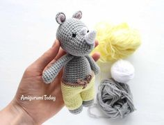 This Cuddle Me Rhino amigurumi dressed in sunny pants is the ideal friend for your little one! Crochet him today with our Cuddle Me Rhino Amigurumi Pattern! Crochet Gratis, Crochet Amigurumi Free Patterns, Easy Crochet Patterns, Cute Crochet, Crochet Dolls, Crochet Designs, Cactus Amigurumi, Mini Amigurumi, Amigurumi Animals