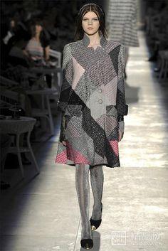 Fashion irregular color coat.