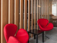 Timber panelling and curvy red chairs make a fashionable statement. Timber Panelling, Red Chairs, Waiting Area, Office Interiors, Melbourne, Curvy, Concept, Furniture, Design