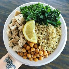 Quinoa bowl with kale, chickpeas, grilled chicken, lemon juice, salt and pepper