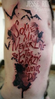 some may never live but the crazy never die.    intense tattoo, but i really like the words