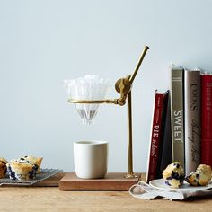 "Dubbed ""the Professor"" for its ability to school you on proper coffeemaking, this brass-and-walnut pour-over stand from Food52 (with a glass dripper by Hario) is a pretty accent on your countertop; $189 