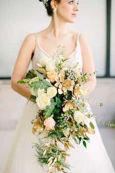 Cascading bouquet. Muted yellows and peach. Spring wedding flower inspiration.
