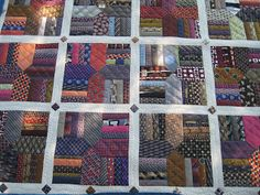 & Ties& - necktie quilt - lots of posts on the process. I have a box full of ties that I need to do something with and this may be just what I need. Necktie Quilt, Shirt Quilt, Quilting Projects, Quilting Designs, Sewing Projects, Quilting Ideas, Old Ties, Tie Crafts, Recycling