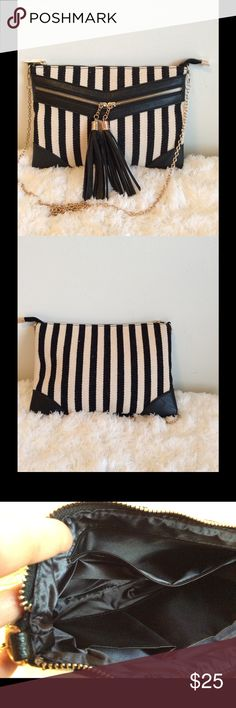 💕SALE💕New Black & Beige Stripe Handbag w/Tassels This bag is NWOT, never used. It has gold shoulder chain and 3 inside compartments. Awesome! Bags Shoulder Bags