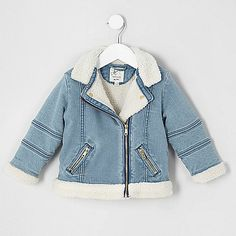 Blue denim Bike collar Fully borg lined Long sleeve Front zip pockets Asymmetric zip front fastening
