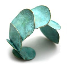 Sibilia Patina Pachacamac Cuff Bracelet    Argentinean jewelry designer Fernanda Sibilia creates contemporary, eclectic, and geometric jewelry that really defies description! Sibilia uses hammered metals in 24k gold plating, old-fashioned brass, 925 silver, copper and bronze creating bold yet contemporary and totally wearable art. Fernanda...