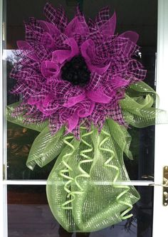 Hot pink & black deco mesh flower wreath. This can be wall decor for a girls room, or be hung outside for spring & summer too! Want one? Any color combination that goes well together would look great! Message me!