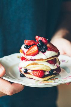 The fluffiest pancakes with mascarpone and sour cream + fresh strawberries and blueberries. This is so easy to make and it's a breakfast fit for a king. We love it. | jernejkitchen.com