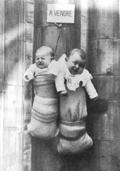FAKE: Unwanted babies sold by poor parents in Italy in 1940's. FACT: This is part of a series of humorous postcards from France by French postcard publisher Saint-Just (recognizable with its logo: the letters A and S and the fleur-de-lys).