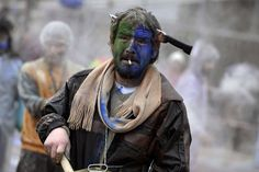 A reveller participates in a flour war during the celebrations of the Clean Monday or Ash Monday in the town of Galaxidi. The celebrations of Clean Monday mark the start of the 40-days lent until the Orthodox easter.