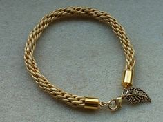 I love the look of this metallic leather. Kumihimo bracelet in pale champagne gold leather.