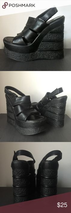 """Vintage 90s Club Kid Platform Sandals These are a pair of vintage 90s club kid platform sandals.  Brand label is illegible, looks like 'di amore'. Platform is a hard, but lightweight, plastic. Front platform is 2"""", heel is 5.75"""". Straps are Velcro adjustable. In good vintage condition. Some wear to the toes and a small white scuff on one heel (see photos). Is true to a size 8. Vegan leather. Tags: goth, rave, festival, candy, party monster, YRU, dollskill, TUK, current mood, public desire…"""