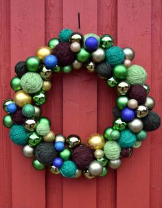 I'm diggin the combo of the yarn & ornament wreaths.