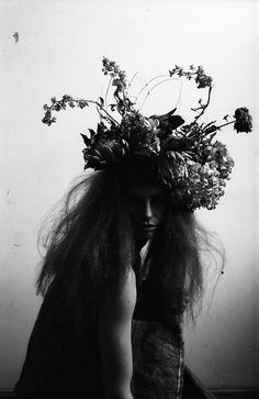 black + white photography with a botanical headpiece.