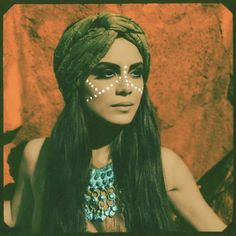 Gypsy girl with scarf turban and face paint.