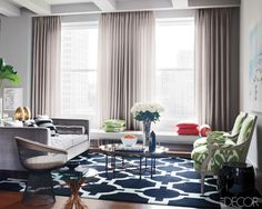 I love the use of the green Ikat fabric on the bergere chairs in the fabulous living room, and that rug!!