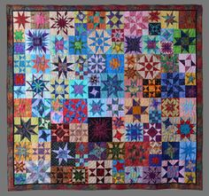 """"""" We Are All Stars"""" , Chelmsford Quilt Guild 2010 raffle quilt, designed by Gerre Clements and quilted by Cheryl Dennis."""
