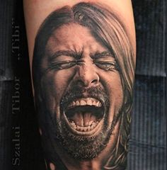 Tattoo by artist Szalai Tibor Tibi.Yallzee's tattoo of the day! #DaveGrohl #FooFighters #inked #tattoo #band #portrait #realism #music