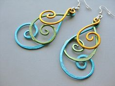 Hammered Peacock BOLD Long Swirly Spiral Feather Aluminum Earrings, Blue Gold Green Silver. by belle azure on Etsy, $18