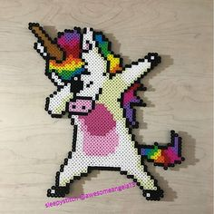 Made dabbing unicorn perler bead sprites because how could I not. Original photo was a t shirt design and it has a shadow I wasn't sure about. So I made one without the shadow as well. Perler Bead Designs, Hama Beads Design, Diy Perler Beads, Perler Bead Art, Pearler Beads, Melty Bead Patterns, Pearler Bead Patterns, Perler Patterns, Beading Patterns