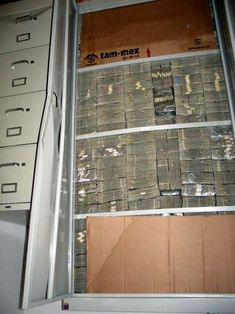 Series of photographs circulating via email and online show millions of dollars in cash seized during a drug raid in Mexico.