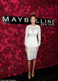 Lovely in lace: Gigi Hadid put her bodacious figure on full display in a sheer dress as she attended Maybelline New York's Fashion Week party on Sunday