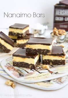 I told myself I wasn't going to do this... I'm only in Canada temporarily, so I didn't want to make any recipes that were specific to this region, but my good friend insisted that I make these infamous Nanaimo Bars and share them on my blog. She handed me her grandmother's recipe, and well... I couldn't resist. I had heard of these Nanaimo Bars, but didn't really know what they were and certainly had never tasted them before. So what are they?? They are a triple layer...