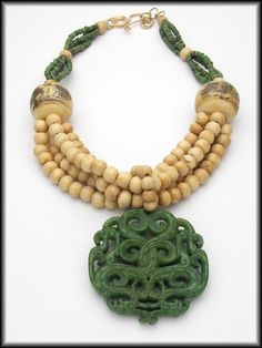 HONG KONG  Handcarved Green Jade Pendant  by Sandra Webster Jewelry www.sandrawebsterjewelry.com