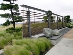 A strong Pacific Northwest aesthetic was desired by the client to recognize their roots in the region. Planting and screen wall design were heavily influenced by the contrast between contemporary architecture and a bold landscape planting style.(Photo: Joseph Fry (PFS))right-click here to save larger image