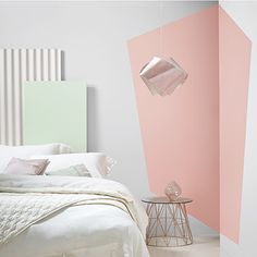 Experiment by painting geometric shapes to add character to a plain, boxy room.