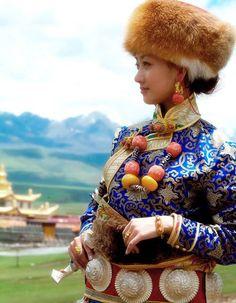 Tibetan festive costume and jewellery. Tibetan costume
