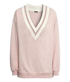 Go for sweet & sporty with this low-cut V-neck sweatshirt in light pink. | H&M Pastels