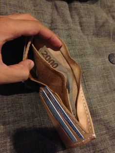 How to Make a Leather Wallet With Secret Compartment