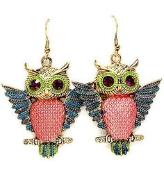 """Antique gold tone, blue-winged owl, with reddish-pink textured belly, purple crystal-stud eyes 2"""" drop/fish-hook"""