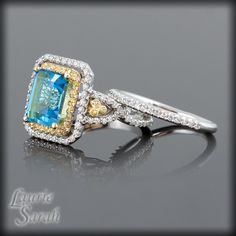 Blue Topaz, Yellow Sapphire, and Diamond Double Halo Engagement Ring with Matching Diamond Wedding Band.