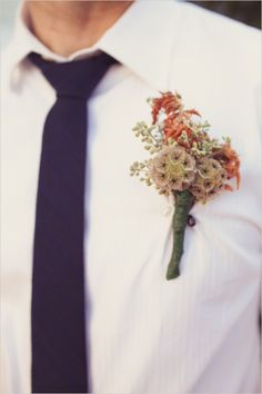 pink and peach groomsmen boutonniere captured by Wildflowers Photography