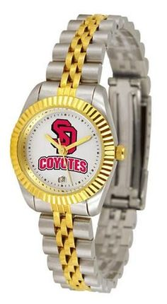 South Dakota Coyotes Womens stainless steel and gold dress watch. College ladies watch gives a classic, business-appropriate look. Features a 23kt gold-plated bezel, stainless steel case and date func