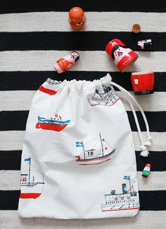 toy bag, love the striped fabric behind.