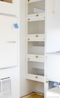 Create storage by filling a closet with lawyer shelves! (Love the latches!)