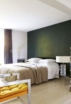 Amazing green wall; nice bedroom space.