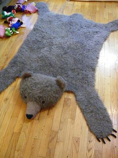Free Bear Rug Knitting pattern.  CLICK LINK FOR PATTERN: http://web.archive.org/web/20100107071700/http:/www.knit1mag.com/extras-faux-bear-rug.php  (Image taken from Ravelry user.)  Though at over $280.00 in yarn alone, I don't think I'll make it, at least not using the pattern's requirements.
