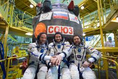 JSC2016e026339 (03/04/2016) --- In the Integration Facility at the Baikonur Cosmodrome in Kazakhstan, Expedition 47-48 crewmembers NASA Astronaut Jeff Williams (left) and Alexey Ovchinin (center) and Oleg Skripochka (right) of Roscosmos pose for pictures March 4 in front of their Soyuz TMA-20M spacecraft in their Russian Sokol launch and entry suits during final pre-launch training. The trio will launch March 19, Kazakh time, for a six-month mission on the International Space Station.