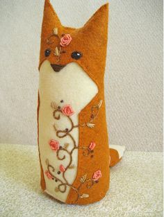 I love the embroidery on this fox, really detailed and very artistic.