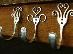 Whimsical wall hooks from sterling silver forks...