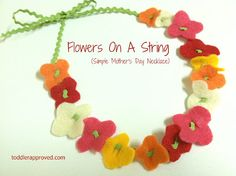 Flowers on a String: Simple Mother's Day Necklace  Cut parallel lines in the middle of the flower and string together with rickrack ( tape on end of rickrack to make it hard like a needle.)