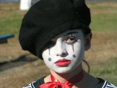 The Mime.  For this one I purchased the beret, white face paint and red ribbon.  Kate wore her own clothes and shoes.  I did her make-up, tied the ribbon and she was ready to go!  I think this is the one I'm most proud of, to date.  Total approx. $3.00.