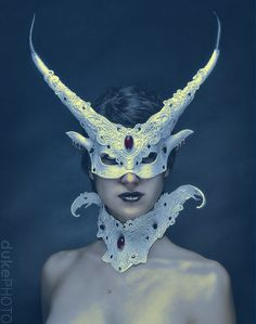 Leather mask, real horns, lace, glass beads.