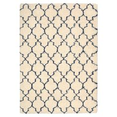Lend a touch of luxe appeal to your living room or master suite with this lovely shag rug, showcasing a classic lattice motif in ivory.  ...