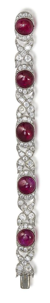 An art deco ruby and diamond bracelet, circa 1925  The five cabochon rubies millegrain-set within cushion-shaped and single-cut diamond oval surrounds, connected by cushion-shaped and rose-cut diamond floral links, diamonds approximately 8.25 carats total, length 17.5cm